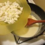 Add chopped egg whites to white sauce