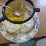 Press egg yolks through a sieve onto the egg whites
