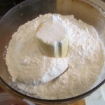 Add 1 cup of flour to processor