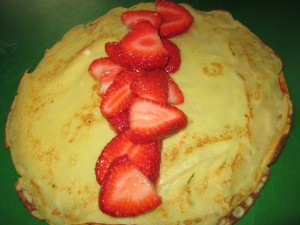 Spoon fruit down the middle of the crepe