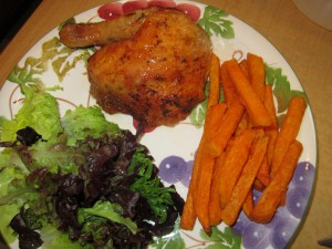 Rub roasted chicken with sweet potato fries and salad