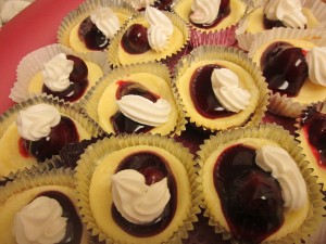 Mini Cheesecakes with cherries and whipped cream