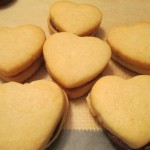 Little heart cookies sandwiched with melted chocolate