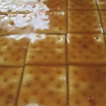 Drizzle crackers with the butter/brown sugar mixture