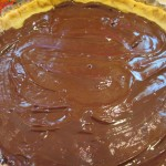 Cover crust with melted chocolate