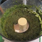 Process basil and olive oil until smooth