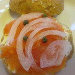 With cream cheese, lox, sweet onion and capers.